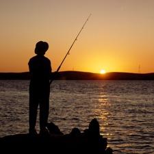Man fishing in delta waters